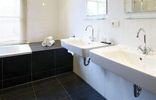 Bagno in camera City Centre Apartments Jolanda