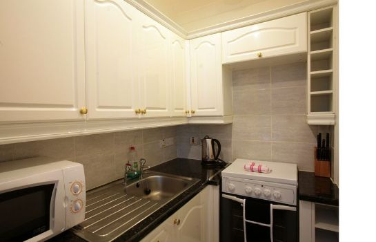 cuisine dans la chambre City Apartments Glasgow City Apartments Glasgow