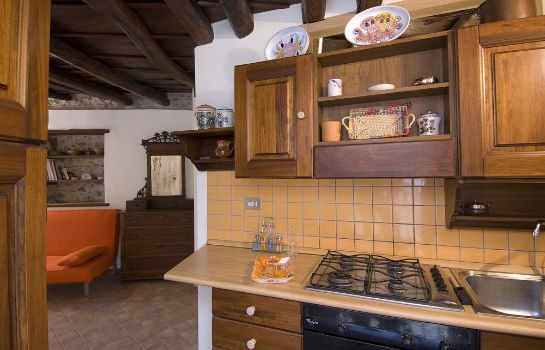 Cucina in camera Vacation Service Apartments