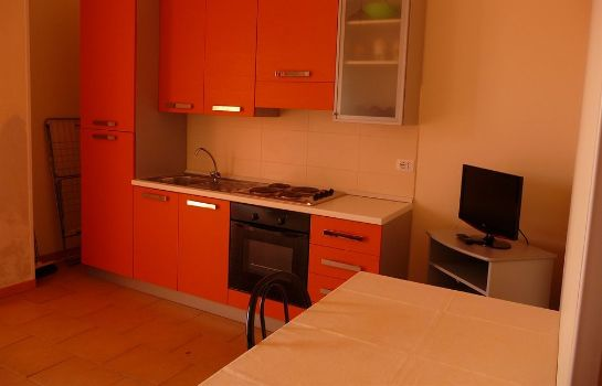 Cucina in camera Agathae Hotel & Residence