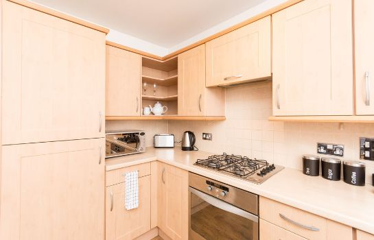 Kitchen in room Holistic Condos Apartments - Albion Gardens