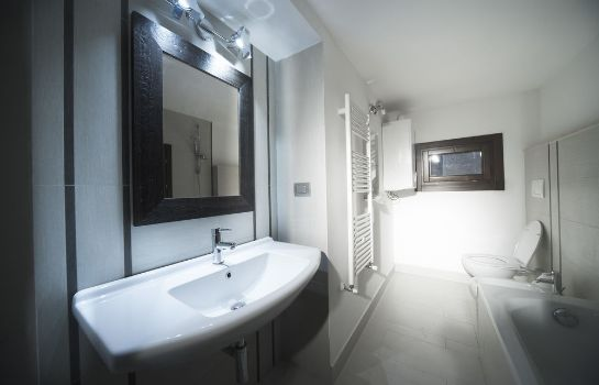 Bagno in camera 64 Suites Apart