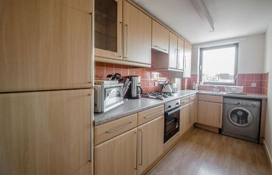 Kitchen in room AM-PM City Centre Apartments