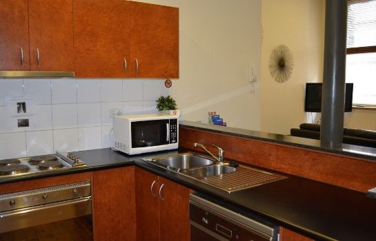 Kitchen in room Melbourne City Stays
