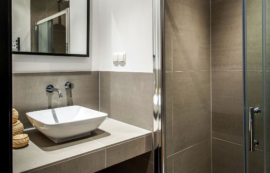 Bagno in camera Tropen Apartments