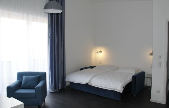 Dreibettzimmer Victoria Living Hotel & Boardinghouse