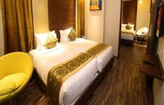 Four-bed room Hotel Stylotel by Jagadish