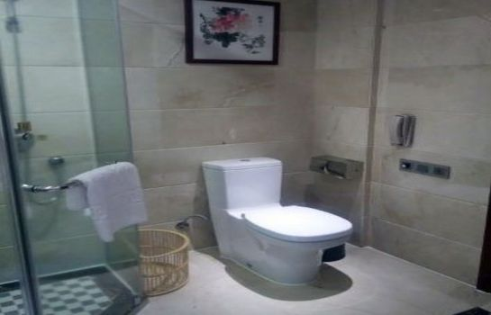 Cuarto de baño Sunshine International Hotel