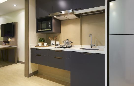 Kitchen in room Oasia Residence Singapore