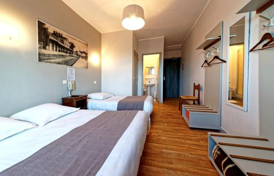 Triple room Commerce et Touring Logis