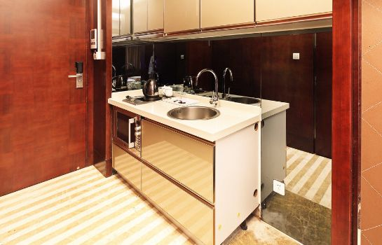 Kitchen in room Xingyi International Service Apartment