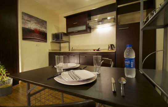 Kitchen in room NewCity Suites & Apartments