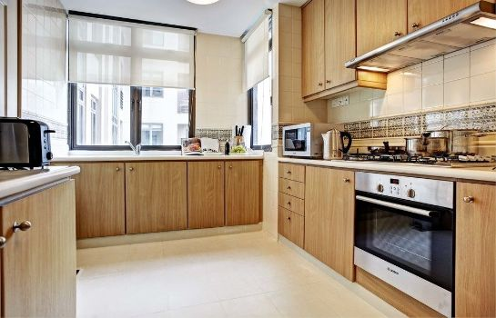 Keuken in de kamer Great World Serviced Apartments