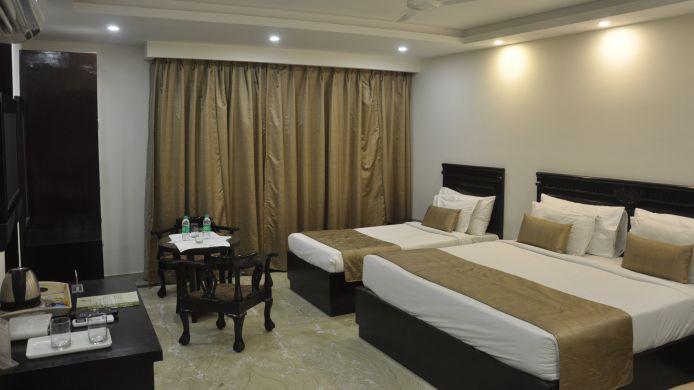 Four-bed room Usha Kiran Palace Hotel & Towers